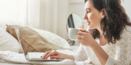 Woman With Coffee on Computer